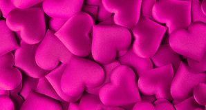 Valentine`s Day. Purple heart shape backdrop. Abstract holiday Valentine background with purple satin hearts. Love. Concept stock image