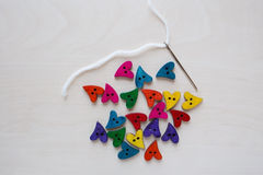 Valentine's day rainbow hearts with Sewing needle Stock Images