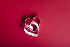 Valentine`s Day red background and white paper hearts Royalty Free Stock Photos