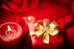 Valentine's Day. Red candles and gift box Stock Image
