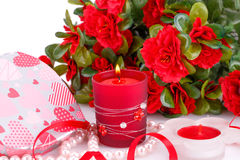 Valentine's day. Red flowers, candles and gift box close up picture Stock Image