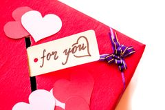 Valentine`s day red gift box with a gap for paper valentines on white background. Valentine`s day holiday. red box for valentines with paper hearts. valentine Royalty Free Stock Photos
