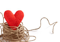 Valentine's Day. Red handmade heart in nest  of twine Royalty Free Stock Images