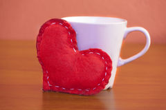 Valentine's Day - Red heart and a coffee mug. royalty free stock photography