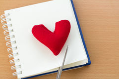 Valentine& x27;s Day with red heart. Open book and red heart on a wooden table Stock Image