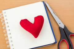 Valentine& x27;s Day with red heart. Open book and red heart on a wooden table Royalty Free Stock Photography