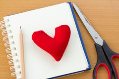 Valentine& x27;s Day with red heart. Open book and red heart on a wooden table Royalty Free Stock Image