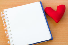 Valentine& x27;s Day with red heart. Open book and red heart on a wooden table Royalty Free Stock Photos