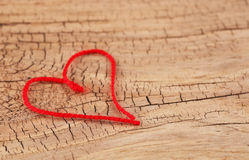 Valentine's Day. Red heart of thread shaped Royalty Free Stock Images