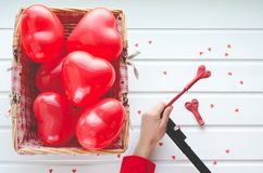 Valentine`s Day, red hearts balloons on white wooden background,. With space to write. Top view Stock Image