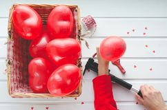 Valentine`s Day, red hearts balloons on white wooden background,. With space to write. Top view Stock Photography