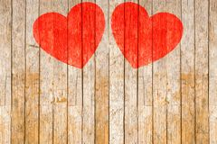 Valentine`s day, Red hearts painted on wooden background Stock Images