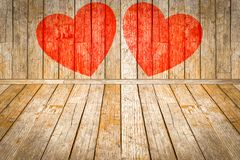Valentine`s day, Red hearts painted on wooden room. Red hearts painted on wooden background Stock Photo