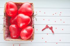 Valentine`s Day, red hearts on a white wooden background. Space. Valentine`s Day, red hearts on white wood bottom and small paper hearts. Space Stock Photography