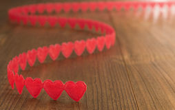 Valentine`s Day red hearts on wood Royalty Free Stock Photo