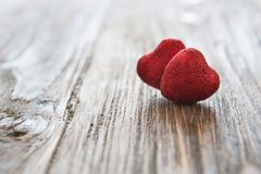 Valentine`s day red hearts on wooden background. Valentine`s day holiday concept royalty free stock images
