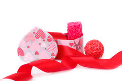Valentine's day. Red ribbon,  candles and gift box isolated on white background Royalty Free Stock Image