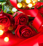 Valentine's Day red roses bouquet over silk Royalty Free Stock Photo