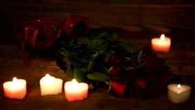 Valentine's Day red roses and candles. stock video