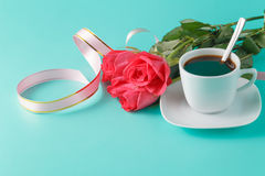 Valentine's Day: red roses, coffee cup and ribbons Royalty Free Stock Photography