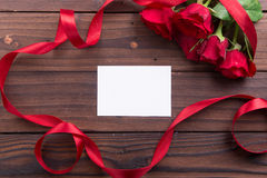 Valentine's Day: red roses and ribbons Royalty Free Stock Image