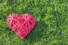 Valentine`s Day. Red straw heart on the grass. Valentine`s Day stock image