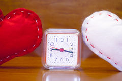 Valentine's Day - red and white hearts and a clock. Stock Photography