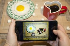 Valentine`s day romantic Breakfast smartphone social networks Stock Photos