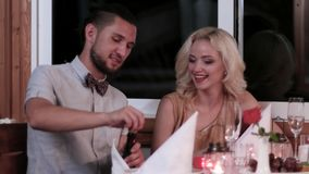 Valentine`s Day, romantic date, loving couple in the restaurant, the evening for lovers, boys and girls in a romantic. Atmosphere in the cafe, beautiful table stock video footage