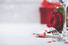 Valentine`s Day or romantic dinner concept. Valentine day or proposal background. Close up view of restaurant table with romantic table place setting. Copy Royalty Free Stock Images