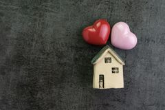 Valentine`s day or romantic living family with love house with c. Eramic miniature house and red heart shape flat lay stock photo