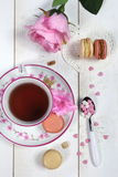 Valentine's Day: Romantic tea drinking with macaroon and hearts Stock Image