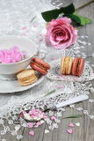 Valentine's Day: Romantic tea drinking with macaroon and hearts Stock Photos