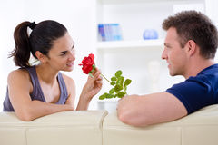 Valentine's Day rose. Romantic man giving red rose to woman - Valentine's Day Royalty Free Stock Image