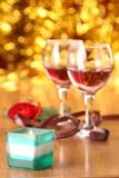 Valentine's day roses, candies and glass Royalty Free Stock Photography