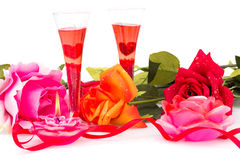Valentine's day. Roses, candles, red ribbon and two glasses isolated on white background Stock Image