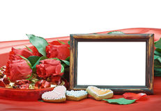 Valentine's day roses and photo frame with space for text Royalty Free Stock Images