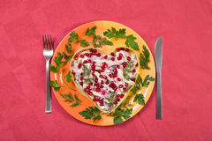 Valentine's day salad with beef tongue on red Stock Photography