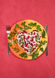 Valentine's day salad with beef tongue on red Royalty Free Stock Images