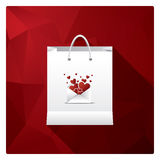 Valentine's day sales or shopping posters with shop bags and different symbols of love. Stock Images
