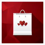 Valentine's day sales or shopping posters with shop bags and different symbols of love. Royalty Free Stock Image