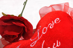 Valentine's day scene. Love pillow and red rose Valentines day scene Stock Images