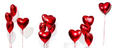 Valentine`s Day. Set of air balloons. Bunch of red heart shaped foil balloons isolated on white stock image