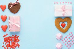 Valentines Day set of objects. Pastel pink and blue colors. Valentines Day set of objects. Gift boxes, red heart shaped cookies, meringues and candy. Pastel stock image