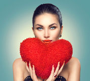 Valentine`s day. Sexy girl with heart shaped fluffy red pillow Royalty Free Stock Photos