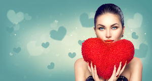 Valentine`s day. Sexy girl with heart shaped fluffy red pillow Royalty Free Stock Images