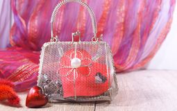 Valentine's Day in shades of red - heart and mesh bag. Happy Valentine's Day in shades of red - heart and mesh bag Royalty Free Stock Photos