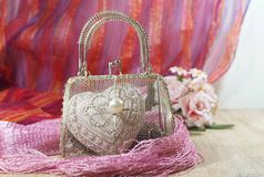 Valentine's Day in shades of red and pink - heart and mesh bag Stock Photography