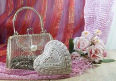 Valentine's Day in shades of red and pink - heart and mesh bag. Happy Valentine's Day in shades of red - heart and mesh bag Royalty Free Stock Photos