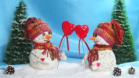 Love snowmen. Love concept. Valentine`s Day. Snowmen in love stand on the snow and keep their hearts out of felt,. Valentine`s Day . Snowmen love couple set stock video footage